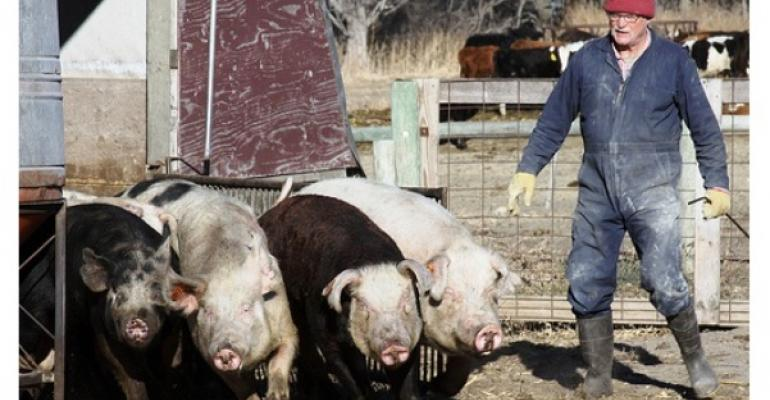 Jim VanDerPol get his pigs ready for market on his Pastures A Plenty farm in Kerkhoven MN