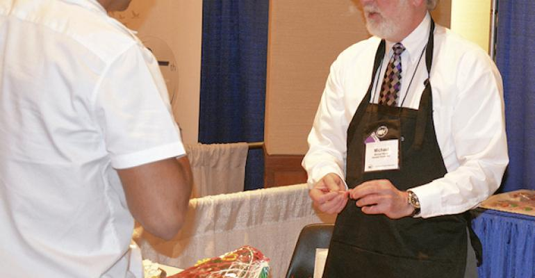 Michael Warne of Daniele Foods talks with a prospective buyer during the recent US Meat Export Federation product showcase