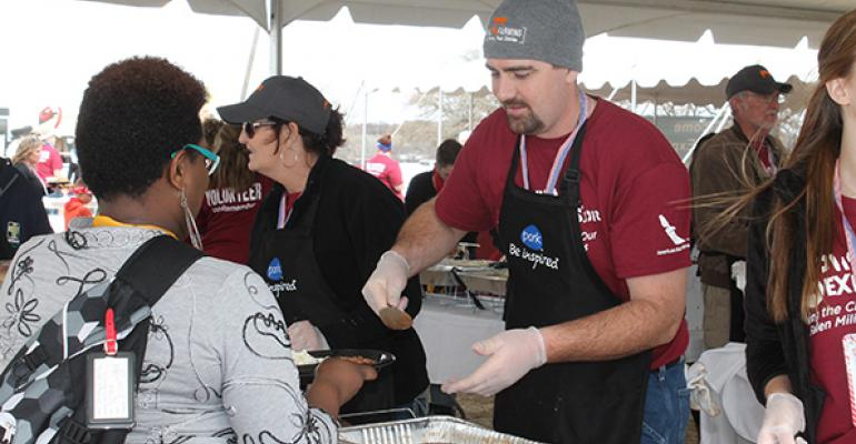 Pork producers serve military families at Snowball Express