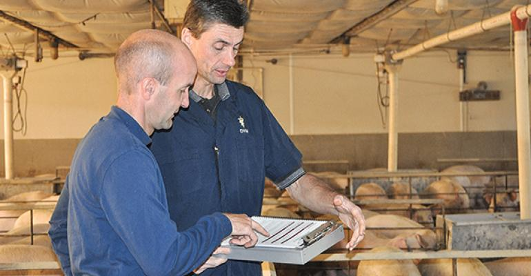 Noel Garbes discusses health management with northern Illinois hog producer Carl Heide