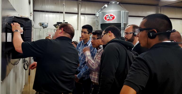 Hog producers from Mexico China and Colombia visit the AP plant in Taylorville Ill