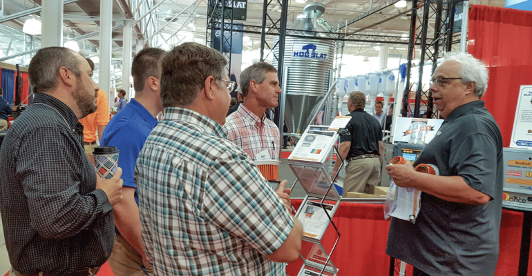 Brian Babb right shows New Product Tour panel members how the adapter works for an easy retrofit installation into existing lighting junction boxes