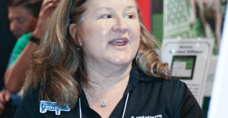 Lisa Butler MetaFarms sales associate passionately explains the attributes of the Assurance software