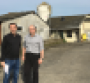 Jean-Pierre Vaillancourt (left) and Frédéric Colin of Zoetis are at a swine farrow-to-finish farm north of Nantes, France.
