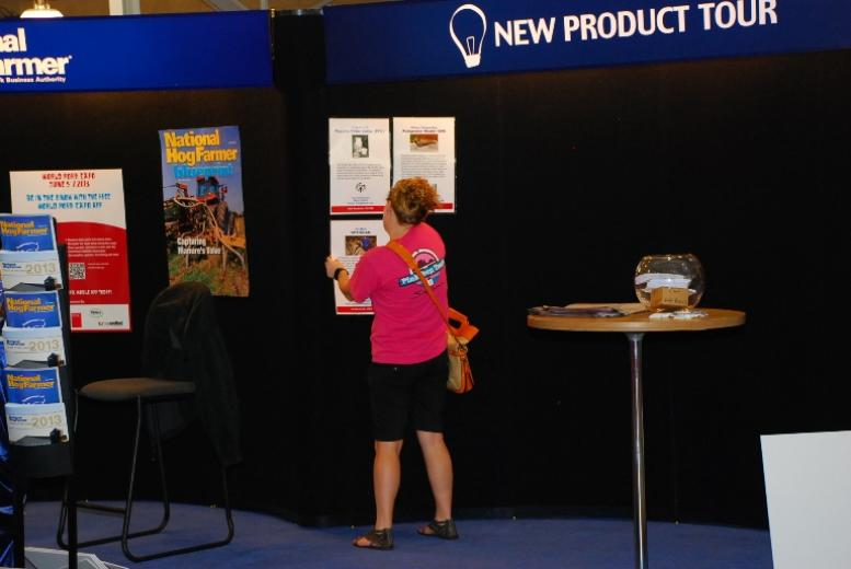 Setting up the National Hog Farmer Booth