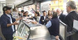 U.S. pork producers and industry leaders visit a retail meat counter in Colombia to explore the variety of cuts and products available.