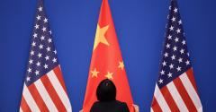 Chinese flag flanked by U.S. flags