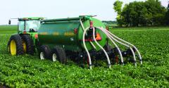 Manure applicator injecting into a soybean field.
