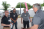 Kevin Thorne, far right, reinforces the importance of controlling fly populations around hog barns to New Product Tour judges (left to right) Brad Leuwerke, Pat Thome and Gary Anderson