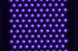 University of Minnesota researchers are testing the efficacy of various plasma sources, including a 2D integrated coaxial micro hollow dielectric barrier plasma discharge array (pictured above). Plasma (purple) is produced inside the holes of the array, through which air is blown. This plasma source has been productively breaking down various viruses — the pathogens are inactivated when they come into contact with the air coming through the holes in the array.
