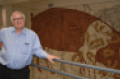 John Patience's work at Iowa State University has benefited the North American swine industry by his close watch on the nutrition and management of the pig.