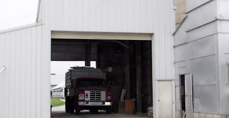 Truck is being filled at a feed mill