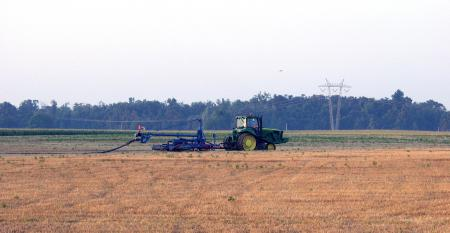Applying hog manure using a drag line system into a field of small grain stubble.